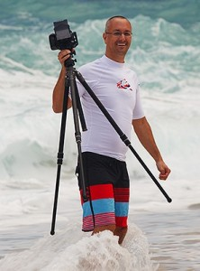 Jon Cornforth photographing surf on the North Shore of Oahu